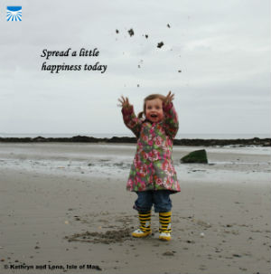 Little girl throwing sand in the air with text: Spread a little happiness today.